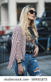 London, England - February 17, 2017: Beautiful model wearing an urban outfit, posing on the street during London Fashion Week.