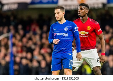 London, England - February 18 2019: Eden Hazard of Chelsea and Paul Pogba of Manchester United during the The FA Cup 5th round match between Chelsea and Manchester United at Stamford Bridge
