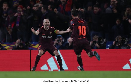 LONDON, ENGLAND - FEBRUARY 20:  Andres Iniesta and Lionel Messi of Barcelona celebrate scoring a goal during the Champions League Round of 16 First Leg match between Chelsea FC and FC Barcelona