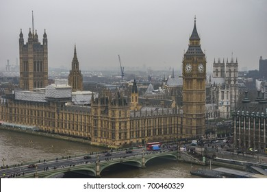 LONDON - ENGLAND, FEBRUARY 2017: Big Ben and Westminster bridge in a typical foggy morning. Winter in London, United Kingdom.