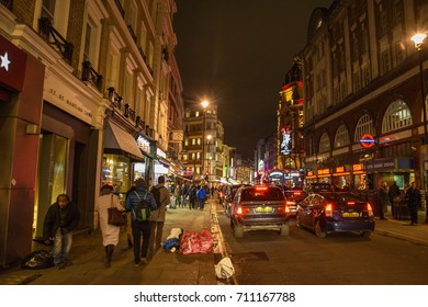 LONDON, ENGLAND - FEBRUARY 2017: Urban view and nightlife at the streets of the famous Chinatown neighborhood in London, United Kingdom.