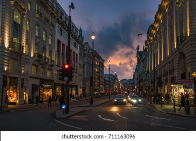 LONDON - ENGLAND, FEBRUARY 2017: Wonderful cityscape view from central London. Traffic at Picadilly Circus square against a heavy cloudy sky. Street photography in a rainy day, London, United Kingdom.