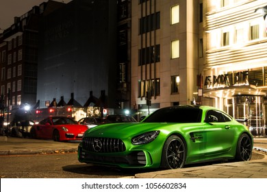 London, England - February 2018: Mercedes-AMG GT R in Green Hell Magno colour parked by a luxury hotel in Mayfair district of central London.