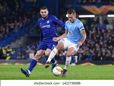 LONDON, ENGLAND - FEBRUARY 21, 2019: Mateo Kovacic and Arnor Ingvi Traustason pictured during the second leg of the 2018/19 UEFA Europa League Round of 32 game between Chelsea FC and Malmo FF.
