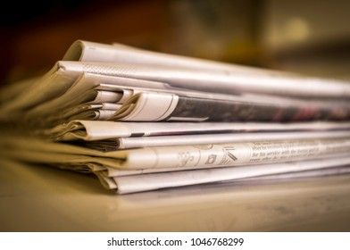 London, England - February 23, 2018: Pile of Newspapers from the United Kingdom