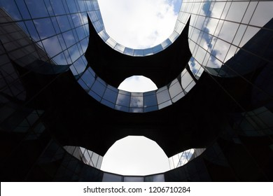 """LONDON, ENGLAND - FEBRUARY 24 2016: Price Waterhouse Coopers (PWC) headquarters located at 7 More London Riverside, London, England.  Affectionately known as the ''Batman building""""."""