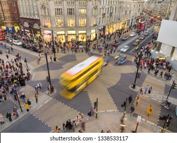 London, England - February 26, 2019: Aerial image of Oxford circus and regent street junction with rush hour traffic of both pedestrians, cars and double deck buses.