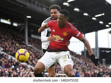 LONDON, ENGLAND - FEBRUARY 9, 2019: Cyrus Sylvester Frederick Christie and Paul Pogba pictured during the 2018/19 Premier League game between Fulham FC and Manchester United at Craven Cottage.