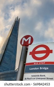 London, England - January 06, 2017: London Bridge bus stop sign with Shard in the background