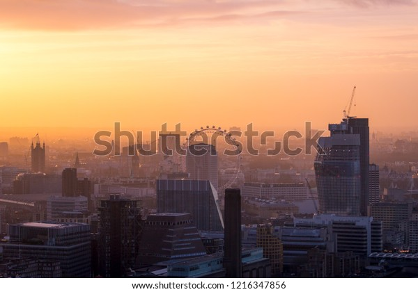 LONDON, ENGLAND - JANUARY 10 2017: London city skyline.  A cityscape at sunset.  Despite the dreamy look, London suffers from high levels of air pollution, affecting the health of many.