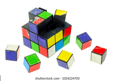 London, England - January 12, 2014: Broken Rubik's Cube puzzle on a white background, The puzzle was invented by Erno Rubik