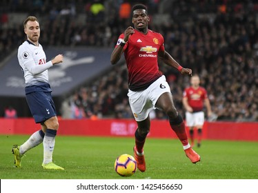 LONDON, ENGLAND - JANUARY 13, 2019: Christian Eriksen of Tottenham and Paul Pogba of Manchester pictured during the 2018/19 Premier League game between Tottenham Hotspur and Manchester United.