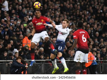 LONDON, ENGLAND - JANUARY 13, 2019: Anthony Martial of Manchester and Christian Eriksen of Tottenham pictured during the 2018/19 Premier League game between Tottenham Hotspur and Manchester United.