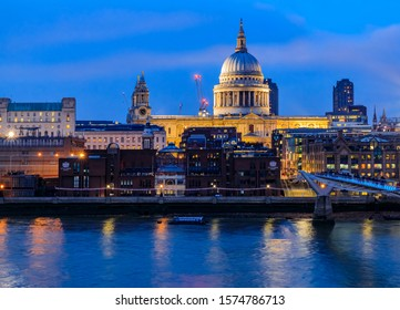 London, England - January 14, 2018: View of the famous St. Paul's Cathedral across the river Thames with Millennium Bridge at sunset
