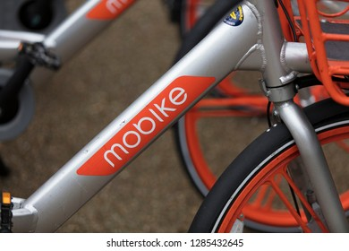 LONDON, ENGLAND - JANUARY 15, 2019: Mobike dockless bicycles parked in a street. Mobike is a bike sharing platform for short distance travel.