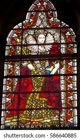 LONDON, ENGLAND - JANUARY 16, 2017 Queen Elizabeth 1 Stained Glass 13th Century Chapter House Westminster Abbey Church London England.  Westminster burial place of Elizabeth.