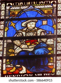 LONDON, ENGLAND - JANUARY 16, 2017 King Henry VIII Stained Glass 13th Century Chapter House Westminster Abbey Church London England.