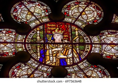 LONDON, ENGLAND - JANUARY 16, 2017 Queen Victoria Stained Glass 13th Century Chapter House Westminster Abbey Church London England.  Burial place of Britain's monarchs since the 11th century.