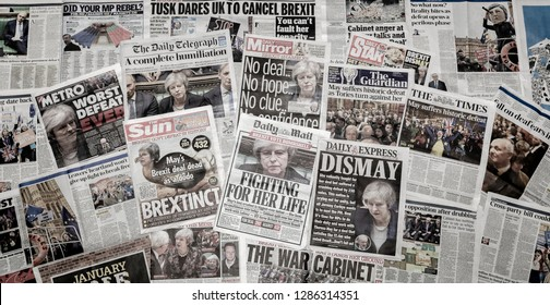 London, England - January 16, 2019: British newspaper front pages reporting Prime Minister Theresa May's Brexit Deal has been rejected in parliament by a record 432 votes in historic commons defeat