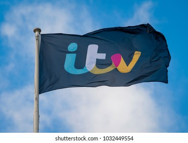 London, England - January 19, 2018:  A Flag bearing the ITV logo flies above ITV Plc Television Studios in London, ITV first launched in 1955.