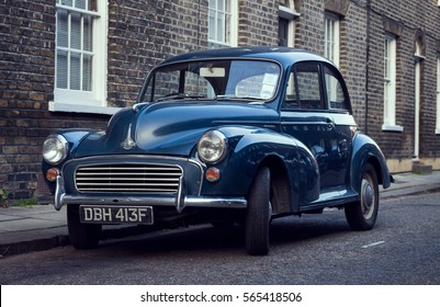 LONDON, ENGLAND - JANUARY 22, 2017: Front view of Blue a Morris Minor 1000 car parked in a street with houses in the background.