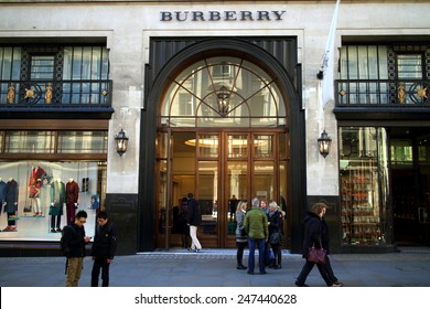 London, England - January 24, 2015: People in front of and entering the Burberry flagship store in Regent Street, London. The brand was founded by Thomas Burberry in 1856