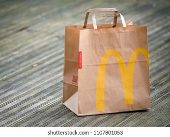 London, England - January 25, 2018: Close up of a McDonald's Take Away Food Brown Paper Bag,  McDonald's is a fast food restaurant chain founded in 1940.