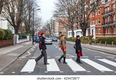 London, England - January 31, 2012:  People crossing the street near the Abbey road Studios