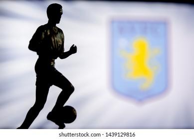LONDON, ENGLAND, JULY. 1. 2019: Aston Villa Football club logo, Premier League, England. Soccer player silhouette.