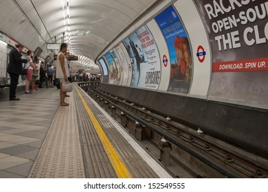 LONDON, ENGLAND - JULY 16: Tube station in motion blur. The Underground is a place of constant movement, people and trains bustling through all day in London on July 16, 2013.