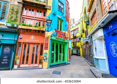 LONDON, ENGLAND - JULY 16,2016.  A view of colourful buildings in Neals Yard during the day. Neals Yard hidden passage near Covent Garden in London, United Kingdom.