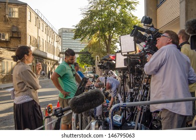 LONDON, ENGLAND - JULY 19: Television journalists wait outside St Mary's Hospital, Paddington for the Duchess of Cambridge to give birth.  The baby will be in line to the throne.