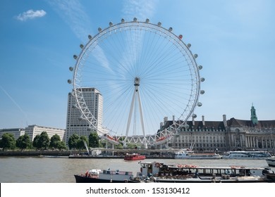 LONDON, ENGLAND - JULY 19:London Eye on the River Thames, London, England on July 19, 2013. The giant ferris wheel constructed for 2000, major feature and landmark continuously turns carrying tourists