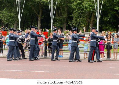 LONDON, ENGLAND -  JULY 20, 2016: Queen's Guard is leaving the Buckingham Palace after the changing of guard proccess. The soldiers charged with guarding the royal residences in the UK