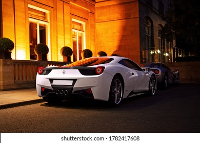 London, England - July 2011: A white Ferrari 458 Italia and a silver McLaren F1 parking in front of the Berkeley Hotel in Knightsbridge, London.