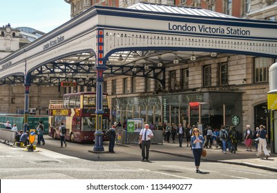 LONDON, ENGLAND - JULY 2018: Exterior view of Victoria railway station in central London. It has a traditional large gall roofed canopy outside the entrance.