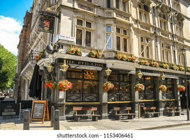 LONDON, ENGLAND - JULY 2018: exterior view of The Red Lion public house in Whitehall in Westminster, London