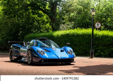 London, England - July 2018: One-off Pagani Zonda 760 MD supercar driving down a park in central London. The Italian car is fitted with a 760 horsepower V12 engine.