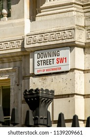 LONDON, ENGLAND - JULY 2018: Sign on the wall of Downing Street in which the residence of the British Prime Minister is located