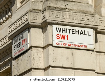LONDON, ENGLAND - JULY 2018: Sign on the wall of Downing Street where the residence of the British Prime Minister is located. Another sign is facing Whitehall, the main road through Westminster.