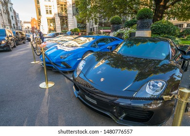 LONDON, ENGLAND - JULY 2018: Supercars parked outside the Dorchester Hotel in London. One of the best places in the world to spot super cars, especially after Ramadan