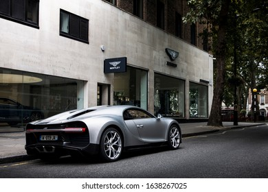 London, England - July 2019: silver Bugatti Chiron supercar parked in Mayfair area of central London, near Berkeley Square car dealerships.