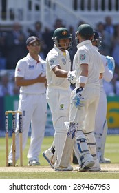 LONDON, ENGLAND - July 21 2013: Michael Clarke shakes the hand of Usman Khawaja after he makes 50 runs during day four of the Investec Ashes 2nd test match, at Lords Cricket Ground