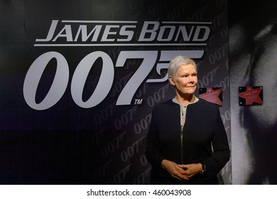 LONDON, ENGLAND - JULY 22, 2016: Judi Dench as Agent M. Madame Tussauds wax museum. It is a major tourist attraction in London