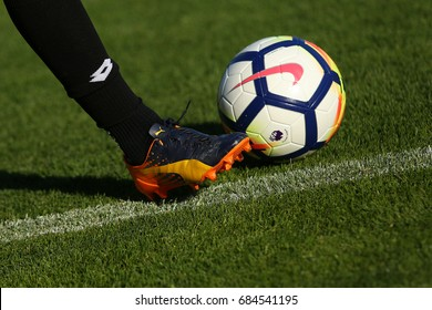 LONDON, ENGLAND - JULY 26, 2017: New Nike Ordem 5 ball. Football player in Puma boots shoots the Official Premier League Ball.