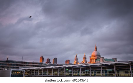 London, England - July 26, 2017 :  London skyline as seen from the Blackfriars Bridge with St Paul Cathedral dome in the background, London, England