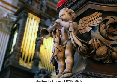 London England -July 27 2017 - wood carving of Cherub with trumpet in St Paul's Cathedral London England