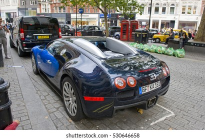 LONDON, ENGLAND - JULY 30: Bugatti Veyron parked on the street on July 30, 2016 in London. One of the best places in the world to spot super cars, especially after Ramadan.
