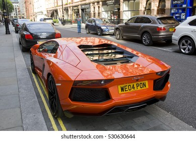 LONDON, ENGLAND - JULY 30: Lamborghini Aventador parked on the street on July 30, 2016 in London. One of the best places in the world to spot super cars, especially after Ramadan.