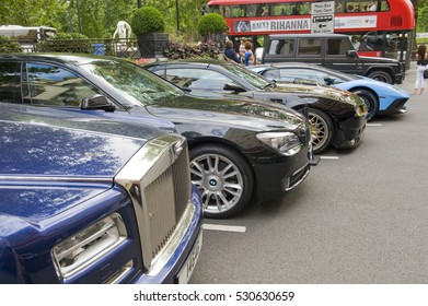 LONDON, ENGLAND - JULY 30: Luxury cars parked outside the Dorchester Hotel on July 30, 2016 in London. One of the best places in the world to spot super cars, especially after Ramadan.